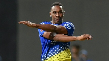 Dwayne Bravo stretches out during warm-up