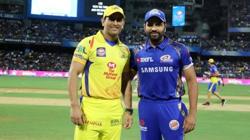 MS Dhoni, back in yellow colours, with Rohit Sharma at the toss