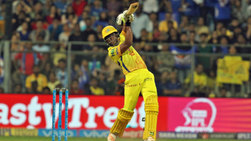 Dwayne Bravo holds his shape after playing a lofted shot