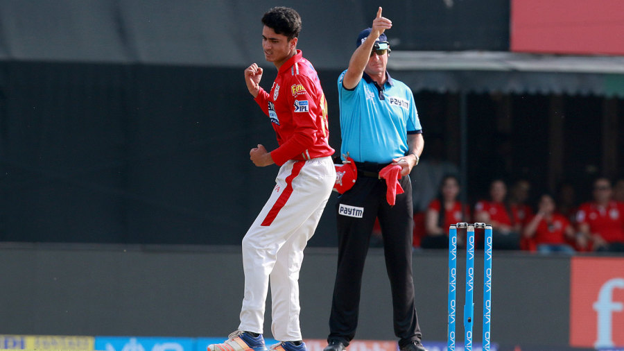 Mujeeb Ur Rahman punches the air after getting his first IPL wicket