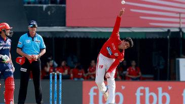 Mujeeb Ur Rahman in his delivery stride