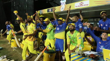 The Chennai dugout reacts to the winning six
