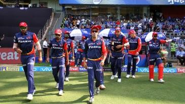Gautam Gambhir leads his team out
