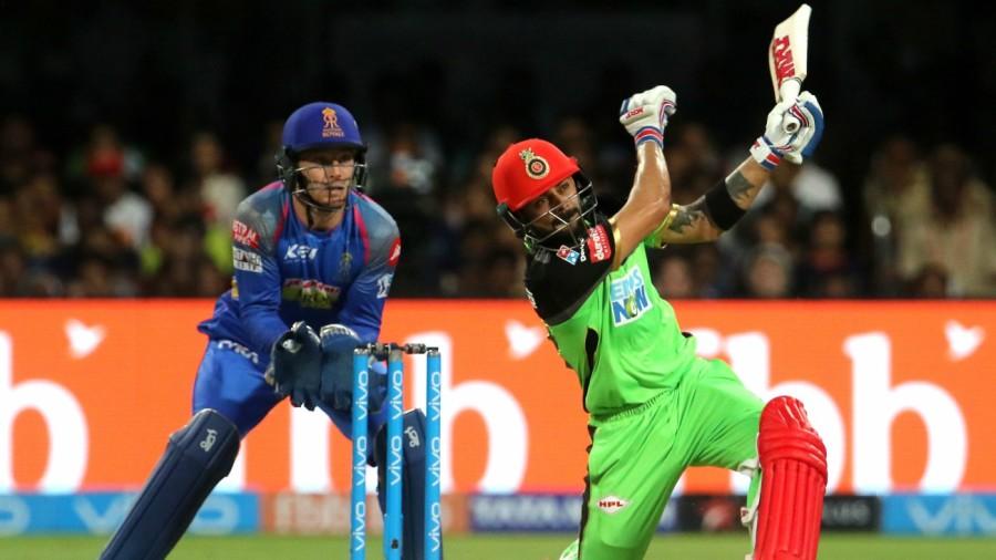 Virat Kohli hits a six despite losing his grip on the bat