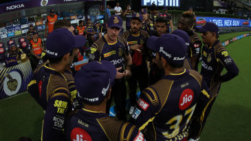 Chris Lynn leads the discussion in the huddle