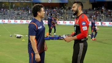 Sachin Tendulkar and Virat Kohli share a light moment