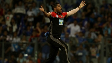 Umesh Yadav takes flight after a double-wicket first over