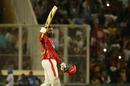 Chris Gayle raises his bat upon reaching his 21st T20 century, Kings XI Punjab v Sunrisers Hyderabad, IPL 2018, Mohali, April 19, 2018