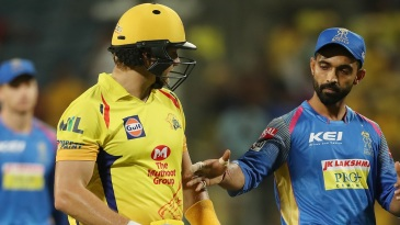 Shane Watson is congratulated by his former team-mate Ajinkya Rahane