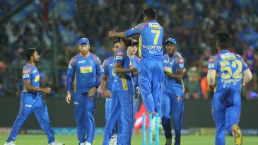 Royals players get together to celebrate a wicket