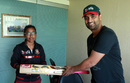 Tamim Iqbal hands over a bat to Rumana Ahmed, Mirpur, April 26, 2018