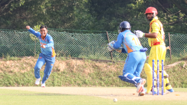 Muhammad Syahadat celebrates after bowling Bilal Hassan for his fourth wicket