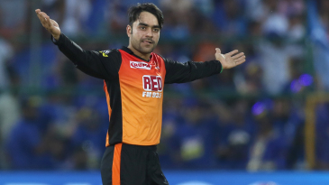 Rashid Khan spreads his arms to commemorate a wicket