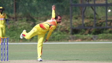 Irfan Afridi bowls during his spell of spin