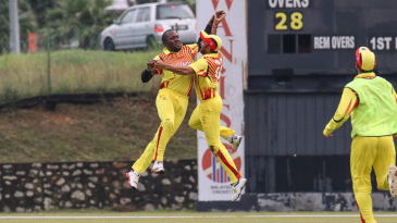 Uganda captain Roger Mukasa and Irfan Afridi leap for joy after a thrilling last-ball win