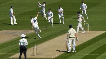 Ollie Robinson wheels away in triumph