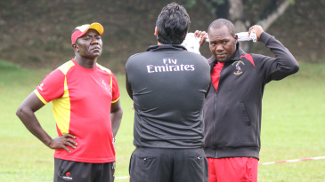 Coach Steve Tikolo and captain Roger Mukasa are stoic after rain denied Uganda victory