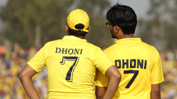 Two MS Dhoni fans watch the proceedings unfold at the MCA Stadium