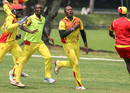 Uganda captain Roger Mukasa sprints off after taking the final wicket to secure victory, Jersey v Uganda, ICC World Cricket League Division Four, Bangi, May 6, 2018