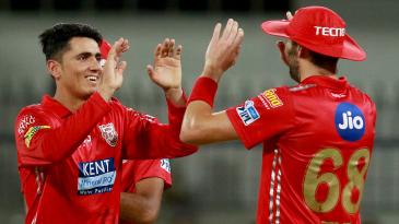 Mujeeb Ur Rahman celebrates with his team-mates