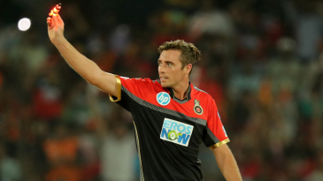 Tim Southee holds a bail aloft