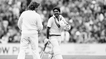 Ian Botham and Javed Miandad share a joke