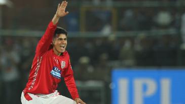 Mujeeb Ur Rahman appeals for a wicket
