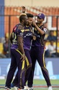 Andre Russell, Javon Searles and Prasidh Krishna celebrate a Kings XI wicket, Kings XI Punjab v Kolkata Knight Riders, IPL 2018, Indore, May 12, 2018