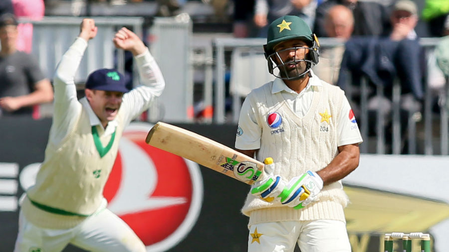 Asad Shafiq grimaces after holing out to Boyd Rankin