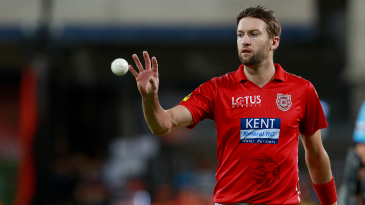 Andrew Tye collects the ball