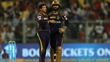 Kuldeep Yadav and Dinesh Karthik celebrate Ajinkya Rahane's wicket