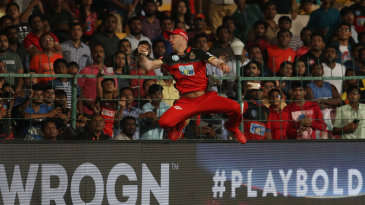 Spectators look on as AB de Villiers pouches the ball