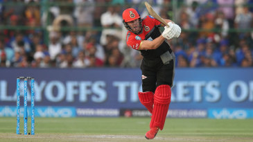 AB de Villiers steps down the pitch and punches straight