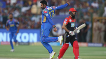Shreyas Gopal leaps in the air after taking a return catch to dismiss Moeen Ali