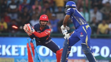 Rishabh Pant completes a stumping of Evin Lewis