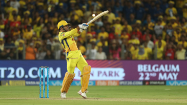 MS Dhoni smashes the ball away