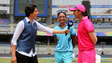 Supernovas' Harmanpreet Kaur and Trailblazers' Smriti Mandhana at the toss of the Women's T20 Challenge with Anjum Chopra