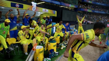 The CSK players and coach go mad. But as usual, MS Dhoni plays it cool