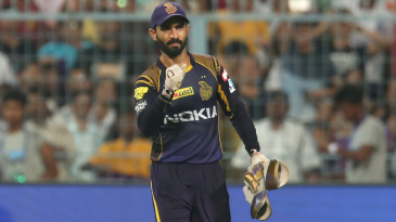 Dinesh Karthik celebrates in a subdued manner