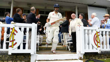 Alastair Cook emerges from the Lord's pavilion