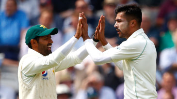 Mohammad Amir gets a high five after dismissing Alastair Cook