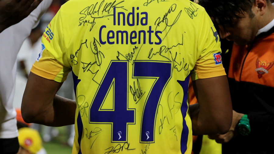 Can you identify the signatures on Dwayne Bravo's jersey?