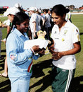 Lisa Sthalekar gives Neetu David a memento at the end of the match, Australia Women v India Women, 3rd ODI, Adelaide, February 28 2006