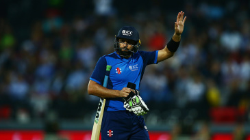 Shahid Afridi waves as he departs following his dismissal
