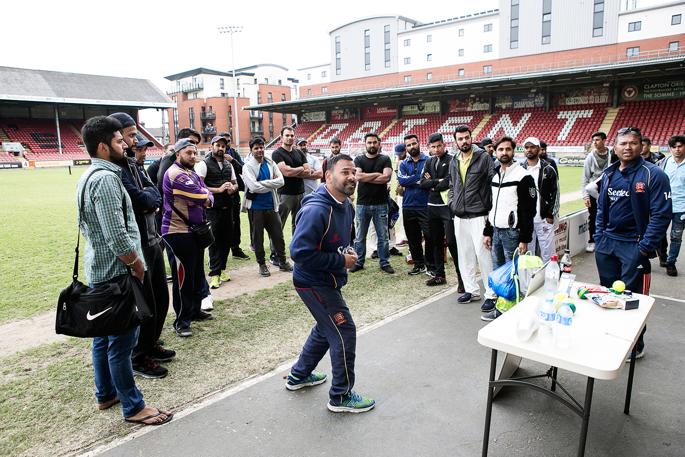 Arfan Akram (centre) explains the rules of the tournament to the participating teams at Leyton Orient