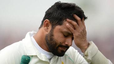 Azhar Ali walks back after being dismissed