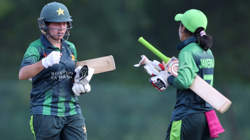 Nahida Khan and Javeria Khan reach out for a fist pump