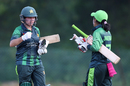 Nahida Khan and Javeria Khan reach out for a fist pump, Pakistan v Thailand, Women's T20 Asia Cup 2018, Kuala Lumpur