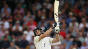 High and handsome: Jos Buttler launches one down the ground