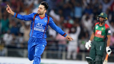 Rashid Khan takes flight after snaring a wicket